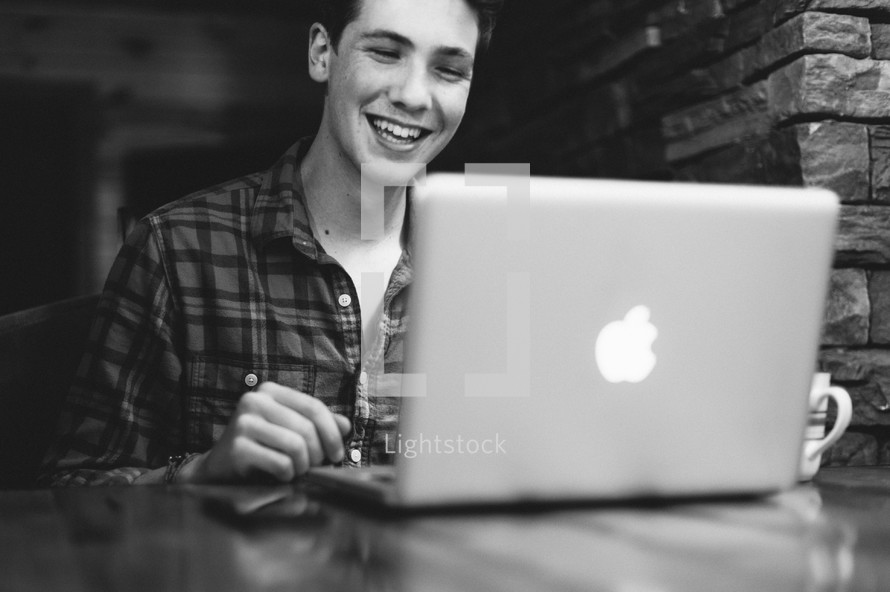 man on the internet on his laptop
