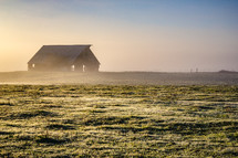 Barn at sunrise on a misty morning.