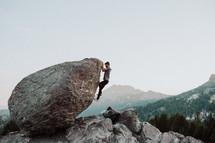 a man climbing up a rock