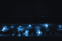 a piano keyboard with blue lights