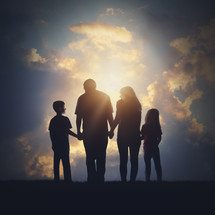 silhouette of a family in glowing sunlight