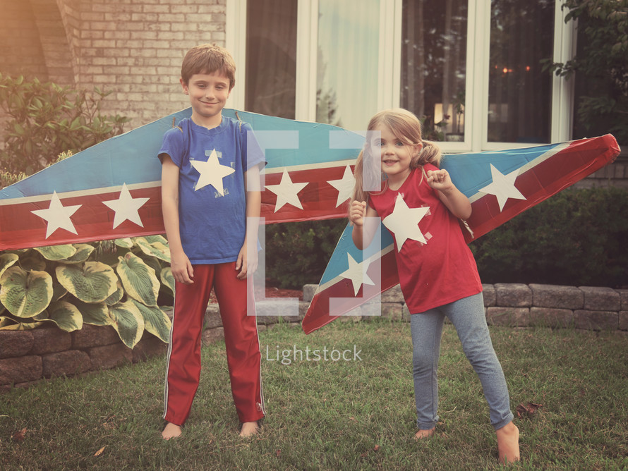 kids with cardboard airplane wings