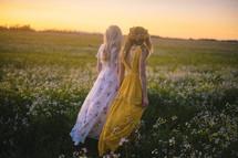 young women walking in a meadow