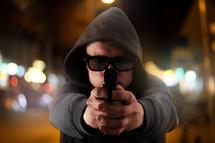 man pointing a gun at the camera