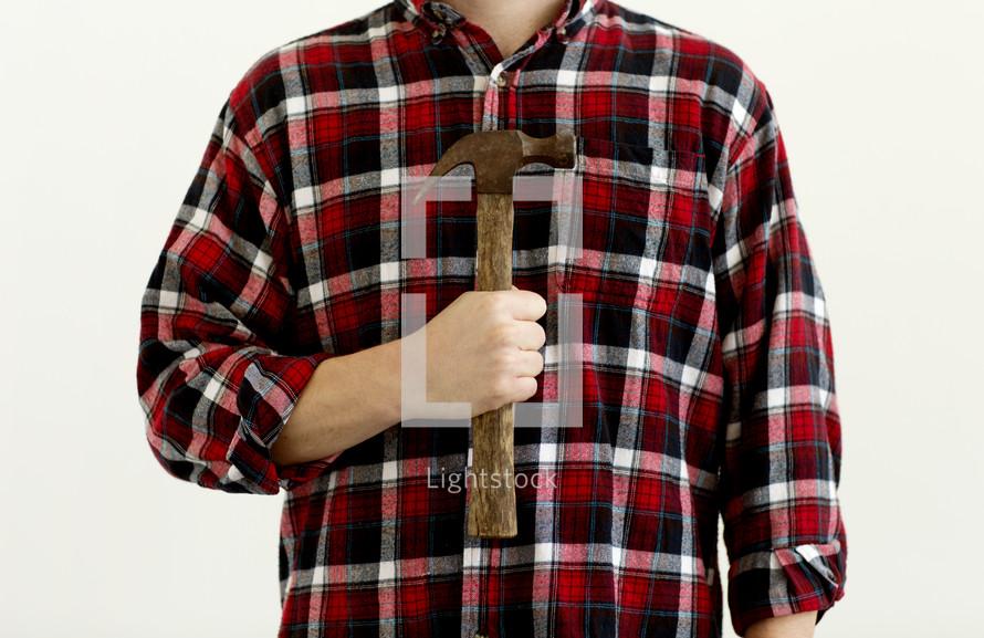 man holding a hammer