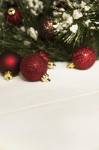 Christmas tree and glittery Christmas ornaments on a white background