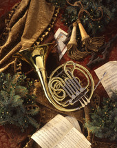 a french horn and sheet music - Christmas scene