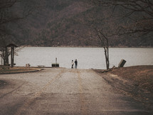 men standing on a boat ramp in winter