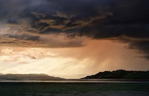 rain clouds over a shore