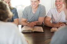 men laughing at a men's group Bible study.