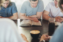 men reading Bibles at a men's group Bible study