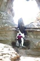 a boy exploring a cave