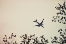 An airplane flies through the sky