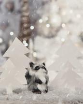 raccoon figurine in snow