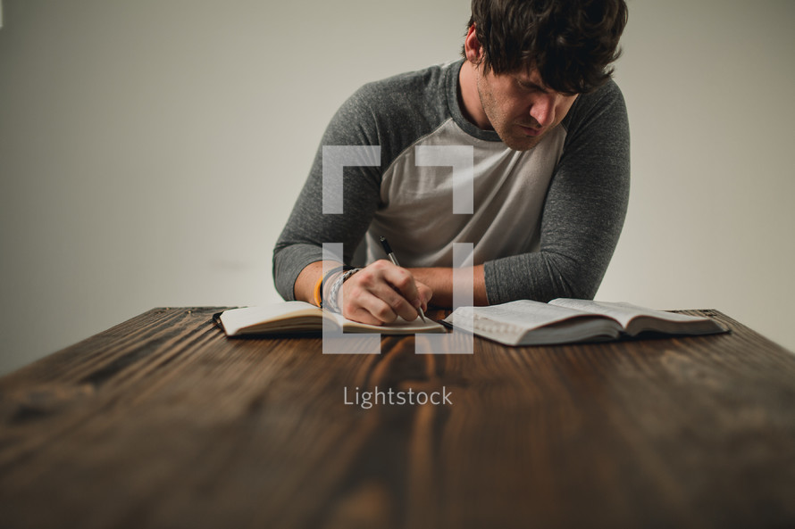 man with a Bible and journal