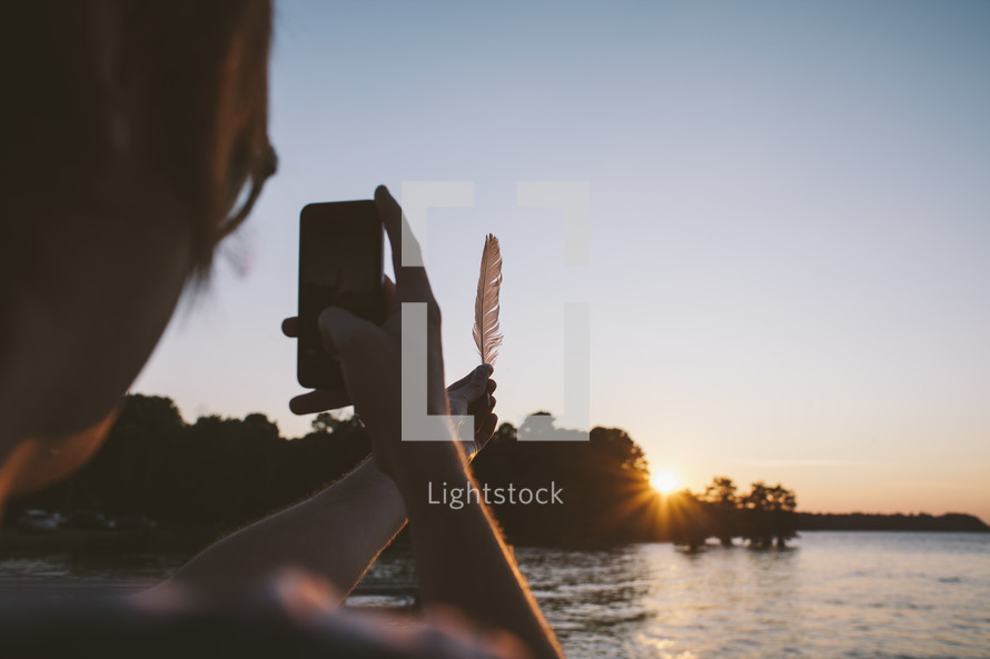Taking a picture of a feather.