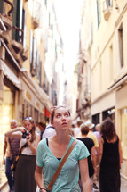 tourists walking in a narrow alley in Venice