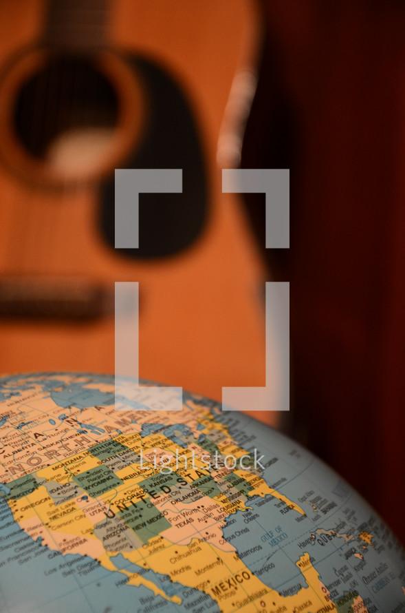 guitar and world globe