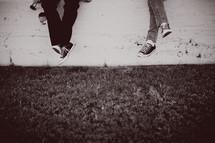 feet dangling in sneakers