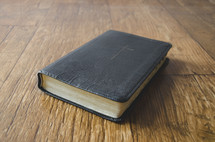 Bible on a wood floor