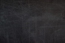 scratches on a blank blackboard