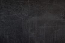 scratches on a blank blackboard