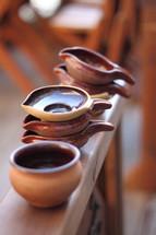 Ceramic bowl and individual soup bowls.