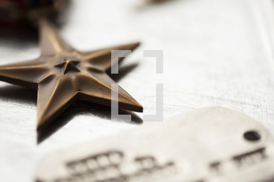 close up of military star and dog tags.