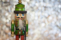 Traditional Wooden Soldier Christmas Nutcracker on a Sparkling Bokeh Background