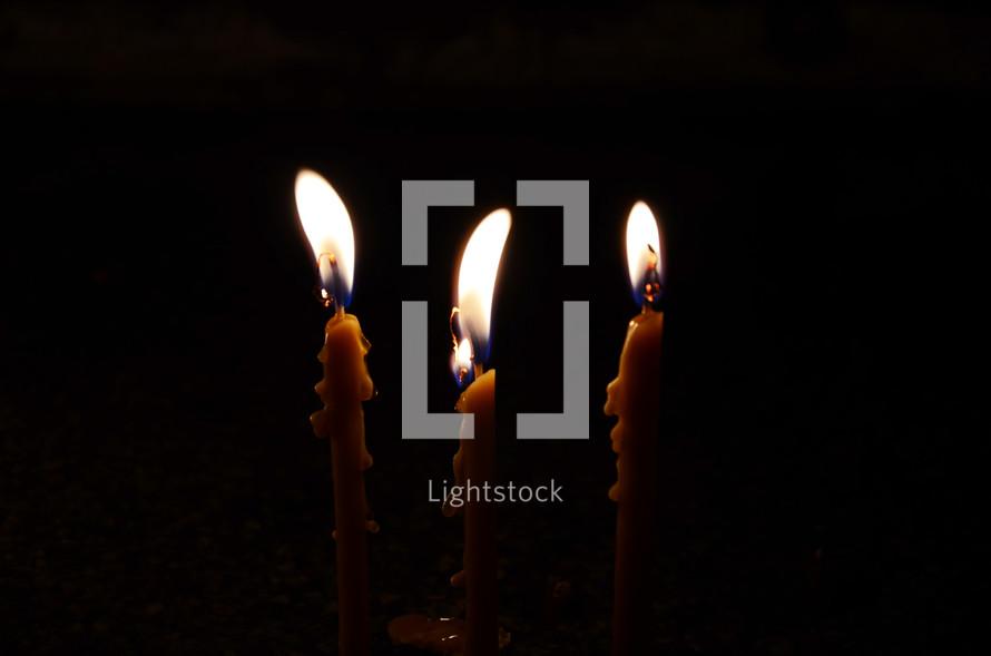 three candles melting wax