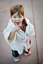 a toddler in a shepherds robe for a Christmas pageant