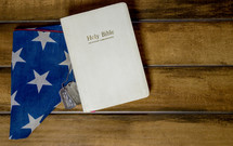Holy Bible, folded American flag, and military dog tags