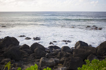 waves washing onto a shore in Hawaii