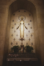 votive prayer candles at an altar