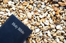 Holy Bible on gravel