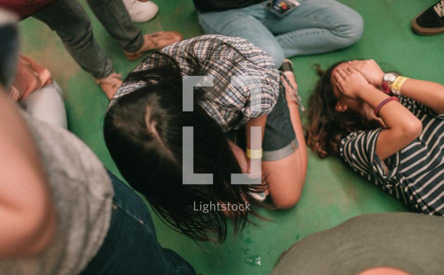 group kneeling at a worship service