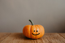 a smiling little pumpkin