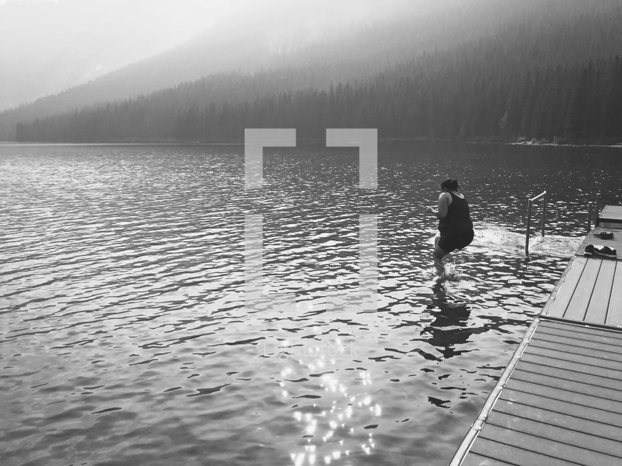 iPhone capture of a woman jumping into cold mountain lake water
