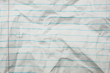 crinkled lined paper