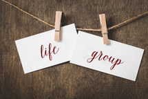 word life group on card stock hanging on twine by a clothespin