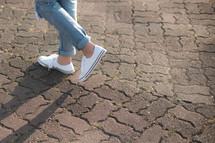 female walking in sneakers