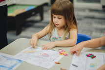 children coloring with crayons