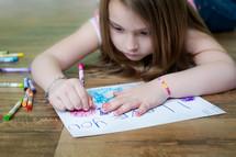 little girl making a card