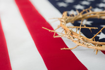 Crown of thorns on an American flag.