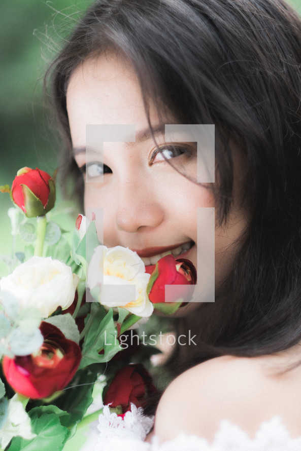 girl holding red and white roses