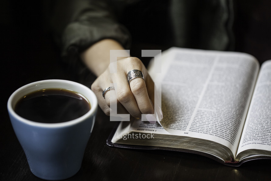 a girl reading a Bible at a Bible study
