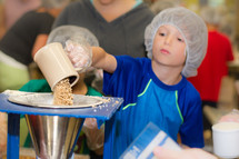 children helping in a food kitchen