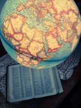 globe and Bible