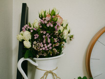 flowers in a white pitcher