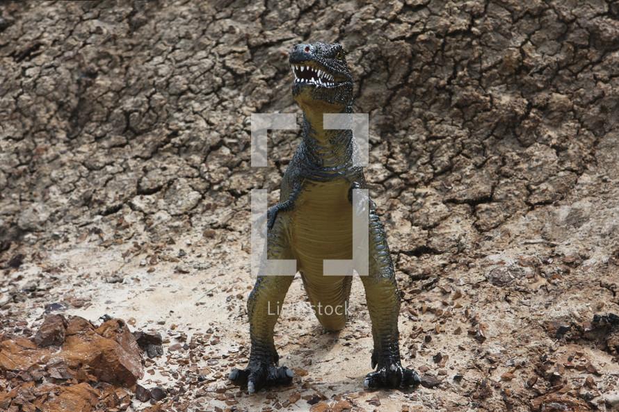 a ferocious t-rex toy outdoors